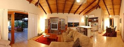 Panorama of living room and kitchen.