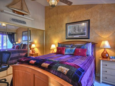 Guest bedroom with queen bed plus paito with ocean view