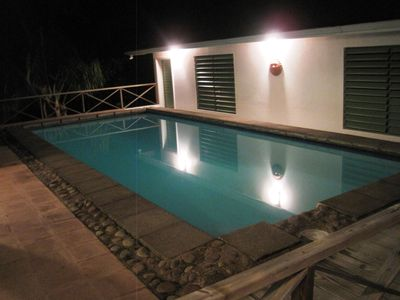 Night views of the guest house and pool. Swim under the bright stars!