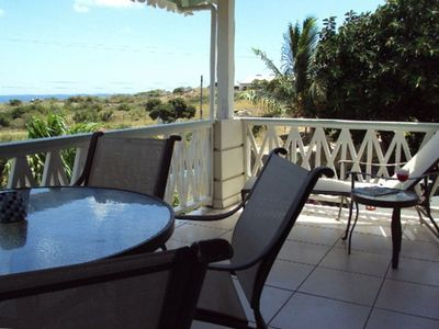 Dine outside on the upper level balcony or relax on the lounger in the sun