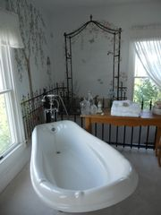 Cape Charles house photo - Close-up of clawfoot tub and hand painted mural in master bedroom 1