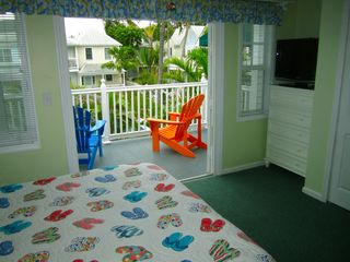 Key West condo photo - Master bedroom balcony and comfortable Adirondack chairs.