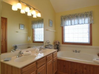 Top Level Master Bath with double vanity, seperate shower and jacuzzi tub.