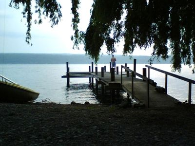 The dock offers unobstructed views, a perfect place to fish, swim, or read.