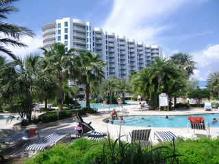 Palms of Destin condo photo - Sky Blue Courtyard with Lagoon Pool, Heated Pool, Whirlpool Spa and West Tower.
