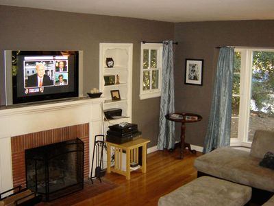 Living room has fireplace and flat-screen TV with X-Box 360 & unlimited Netflix
