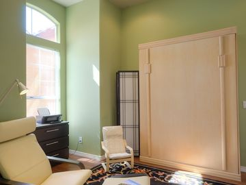 Third bedroom can be an office or retreat with Queen Murphy bed folded into wall