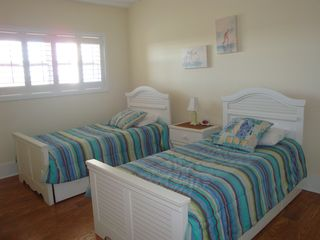 Wrightsville Beach condo photo - Guest Bedroom with 2 Twin Beds with Trunks - sleeps 4 in this room!