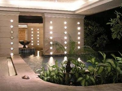 Pool at night - Roman style jacuzzi area