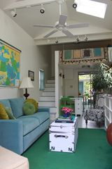 New Orleans studio photo - Studio living room with sleeping loft above. Sofa pulls out as queen sleeper.