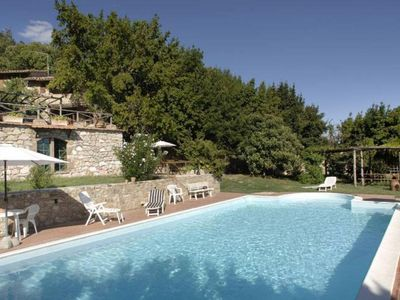 stone farmhouse with pool and views of Todi