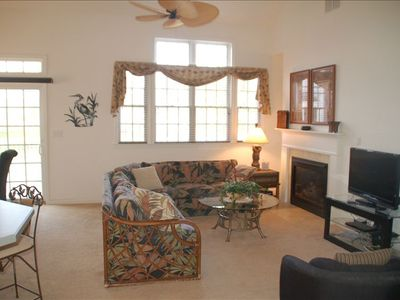 "Great Room from foyer showing couch, 37"" flat screen HD/TV with DVR and wireless"