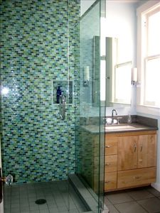 Fab, power rain shower in an exquisite two walled tile unit. Invigorating.