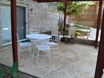 Patio with table for 4, plus additional chairs