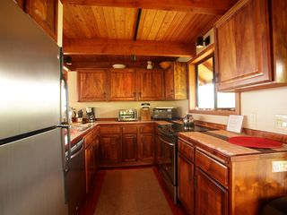 Captain Cook house photo - Beautiful, fully stocked kitchen with Koa cabinets and new appliances.