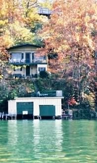 View from Lake Lure of Cottage and Boathouse during glorious fall color season