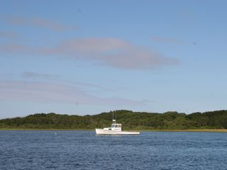 A lobster boat moored in Polpis Harbor--a few minutes drive from home. - Siasconset house vacation rental photo