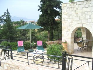 Almirida villa rental - Patio with views to Aspro Village and Souda Bay