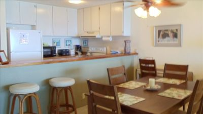 New lining room set & granite counter tops in the kitchen.
