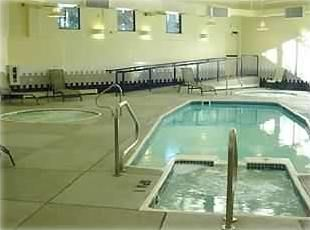 Silverthorne condo photo - Clubhouse pool with three hot tubs and dry sauna.