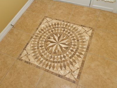 Beautiful mosaic in entryway.