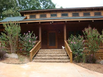 Clayton cabin rental - Front door, paved driveway, covered parking on left of house.