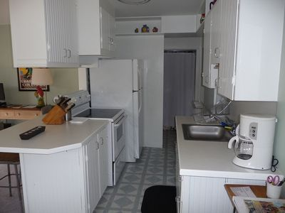 plenty of room in the kitchen, with full size fridge and stove