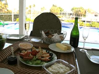 Vacation Homes in Marco Island house photo - Enjoy the famous Marco Stone crabs from a local market sitting by the pool