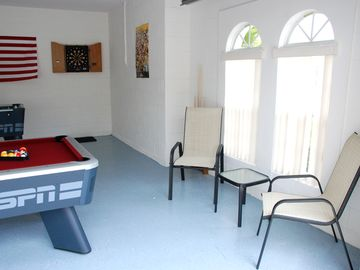 Games Room with natural light - showing darts & pool table.