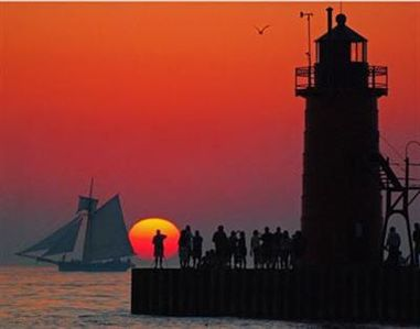 One of many sunsets on our South Pier with the Friends Goodwill Ship sailing...