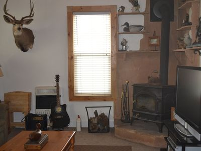 Wood Burning Stove with Large Flat Screen TV.