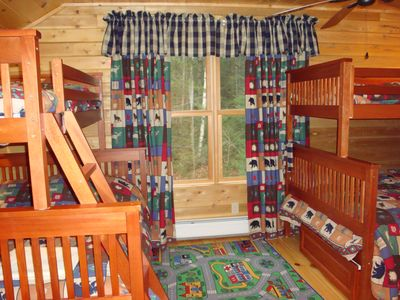 Kids' Bunk Room with one twin & two full beds, plus plenty of room to play