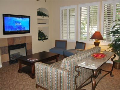 Comfortable Living Room with Hugh Flat Screen Hi Def. TV.
