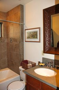 Private bath for Bear Cave bedroom with custom tile, tub/shower