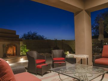Scottsdale North house rental - The outdoor living room includes a comfy couch and chairs with a ceiling fan.