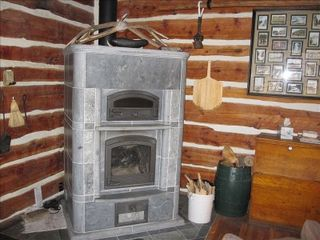 Gardiner cabin photo - Tulikivi Wood stove with Bake oven from Finland. 4800 pounds,for use in winter.