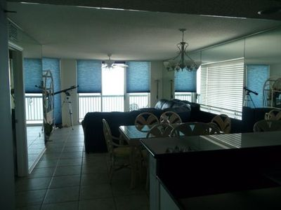 Ocean Drive Beach condo rental - Looking from kitchen at breakfast bar, dining table and living area.