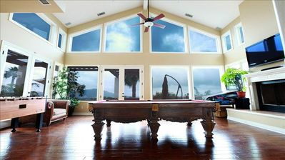 Expansive game room with pinball, pool table, foosball, fireplace, satellite tv.