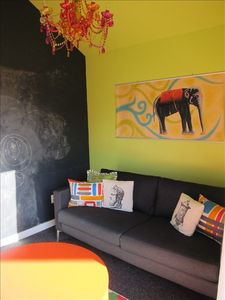 TV room with chalkboard wall for the kids