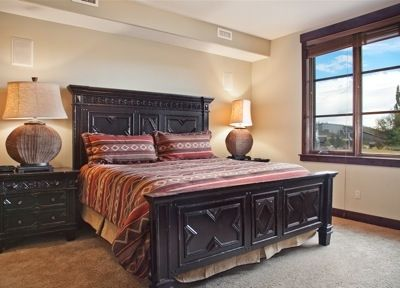Master bedroom with golf course and mountain views