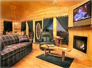 Living room has fireplace, large HDTV, sleeper sofa and two rocker recliners