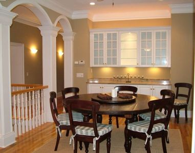 Dining room provides additional seating for eight people.
