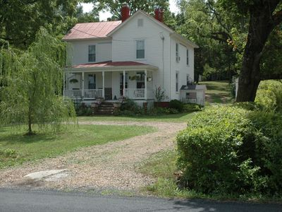 Shenandoah house rental - Privacy fence and hedge separate neighboring property.