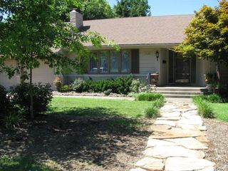 Springfield house rental - Front of House! WELCOME Mature Landscape, roses, and night lighting.