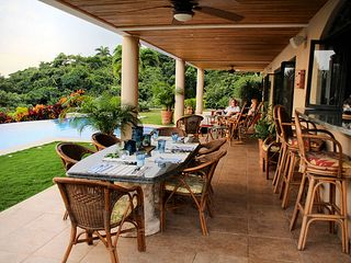 Nosara villa photo - Dining area by the infinity pool Rolf Sommer photo