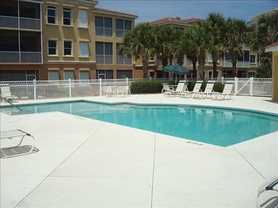 Flagler Beach condo rental - The pool is heated with plenty of deck chairs and a covered deck.