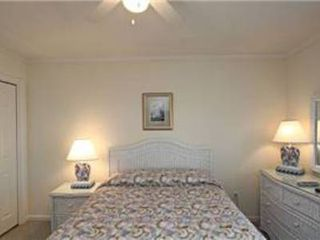 North Ocean City townhome photo - Shell bedroom showing ceiling fan and light, with dresser and closet.