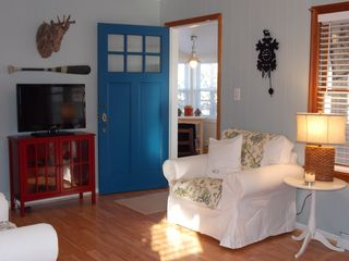 Harbor Beach cottage photo - TV and Blue Doorway leading to Mackinaw Room.