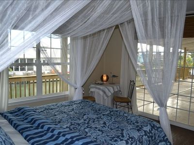 Bright 3rd bedroom with canal, sunset views and access to our large upper deck.