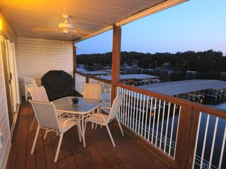 Osage Beach condo photo - The Deck includes a ceiling fan, Gas Grill, and Seating for 8 w/ a great View!
